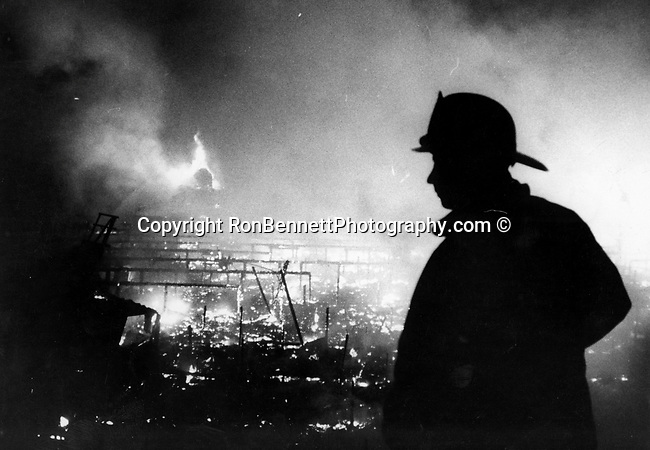 Fireman stands at Pier fire Los Angeles California, Los Angeles is one of the premier US gateways for international trade and commerce, Fine Art Photography by Ron Bennett, Fine Art, Fine Art photography, Art Photography, Copyright RonBennettPhotography.com ©