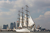 London, UK. 9 September 2014. The Polish Tall Ship Dar Mlodziezy at Canary Wharf and the Millennium Dome.  The Tall Ships that have taken part in the Royal Greenwich Tall Ships Festival 2014 leave Greenwich in a Parade of Sail down the River Thames.