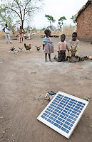 ZAMBIA, Chipata, children in village, solar panel for battery recharge SAMBIA, Chipata, Kinder in einem Dorf, Solar panel zur Ladung einer Batterie