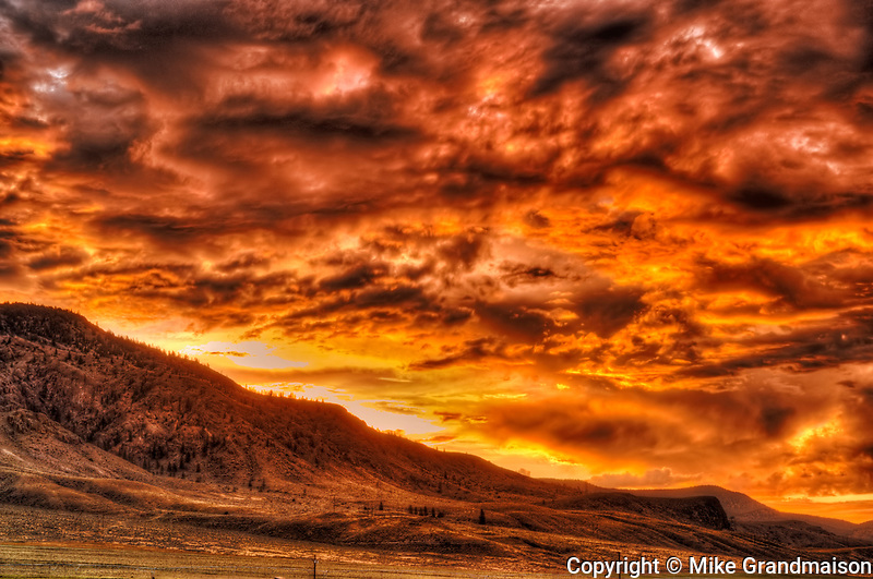 Stormy clouds over grasslands at sunrise, Cache Creek, British Columbia, Canada