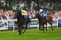 Winner of The Bathwick Tyres Handicap, Koeman (yellow) ridden by John Egan and trained by Mick Shannon   during Ladies Evening Racing at Salisbury Racecourse on 15th July 2017