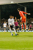 Fulham's Marcus Bettinelli heads the danger clear during the Carabao Cup match between Fulham and Bristol Rovers at Craven Cottage, London, England on 22 August 2017. Photo by Carlton Myrie.