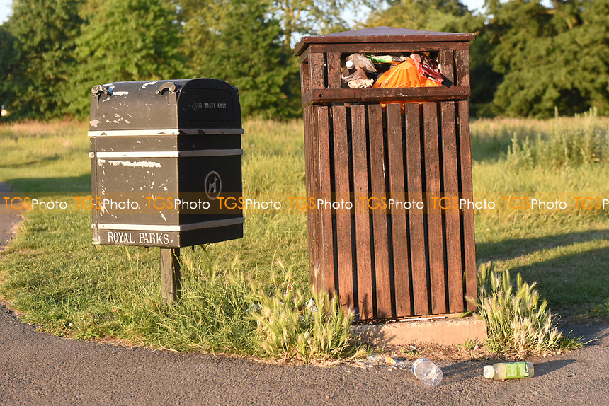 Bins overflowing after members of the public enjoy the warm weather in Regents Park during the coronavirus pandemic