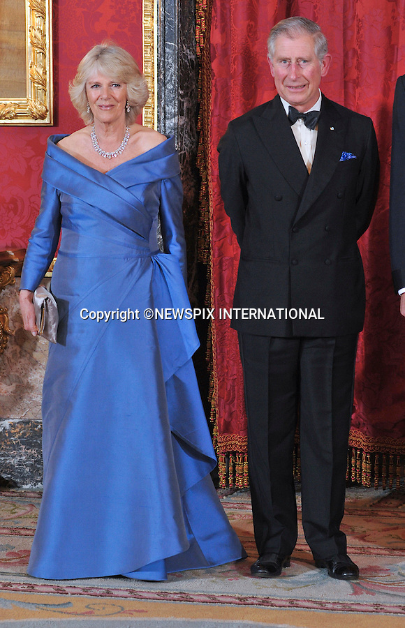 "PRINCE CHARLES AND CAMILLA, DUCHESS OF CORNWALL.WELCOMED BY CROWN PRINCE FELIPE AND CROWN PRINCESS LETIZIA OF SPAIN.The two royal families meet for the official welcome dinner at the Royal Palace of Madrid (Palacio Real de Madrid/Palacio de Oriente), Madrid_30/11/2011..Mandatory Credit Photo: ©Dias/NEWSPIX INTERNATIONAL..**ALL FEES PAYABLE TO: ""NEWSPIX INTERNATIONAL""**..IMMEDIATE CONFIRMATION OF USAGE REQUIRED:.Newspix International, 31 Chinnery Hill, Bishop's Stortford, ENGLAND CM23 3PS.Tel:+441279 324672  ; Fax: +441279656877.Mobile:  07775681153.e-mail: info@newspixinternational.co.uk"