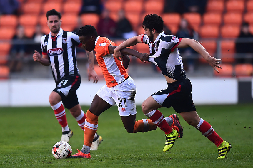 Blackpool's Bright Osayi-Samuel holds off Grimsby Town's Zak Mills<br /> <br /> Photographer Richard Martin-Roberts/CameraSport<br /> <br /> The EFL Sky Bet League Two - Blackpool v Grimsby Town - Saturday 8th April 2017 - Bloomfield Road - Blackpool<br /> <br /> World Copyright &copy; 2017 CameraSport. All rights reserved. 43 Linden Ave. Countesthorpe. Leicester. England. LE8 5PG - Tel: +44 (0) 116 277 4147 - admin@camerasport.com - www.camerasport.com