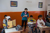 Tibetan teacher Karma Choedon teaches blind and visually impaired students at the School for the Blind in Tibet, in the capital city of Lhasa, September 2016.