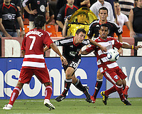 Stephen King #20 of D.C. United heads the ball away from David Ferreira #10 of FC Dallas during an MLS match at RFK Stadium in Washington D.C. on August 14 2010. Dallas won 3-1.