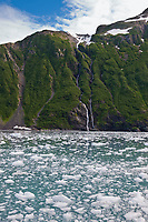 Brash ice from Surprise glacier, Chugach mountains waterfall, Harriman Fjord, Prince William Sound, southcentral, Alaska.