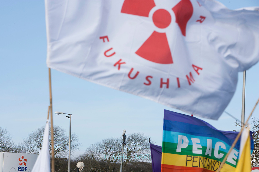 Remember Fukushima flags held by protesters at a march against the building of  Hinkley C power station, Somerset  and the UK government's choice of Nuclear power as the mainstay of England's power supply.