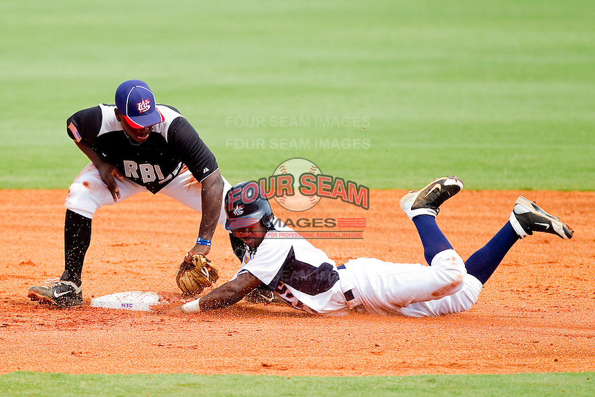 Ron Miller #20 of RBI puts the tag on Kyle Moore #7 of STARS as he tries to steal second base at the 2011 Tournament of Stars at the USA Baseball National Training Center on June 26, 2011 in Cary, North Carolina. (Brian Westerholt/Four Seam Images)