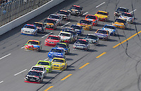 Apr 27, 2008; Talladega, AL, USA; NASCAR Sprint Cup Series driver Denny Hamlin (11) leads the field during the Aarons 499 at Talladega Superspeedway. Mandatory Credit: Mark J. Rebilas-