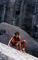 Girl posing like a wild one at a Rock formation,Queensland Australia