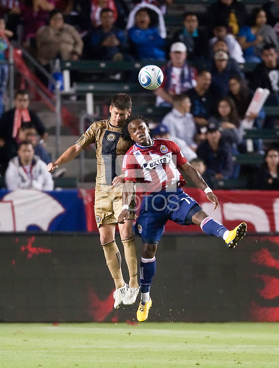 Philadelphia Union defender Cristian Arrieta (26) goes up to head the ball from Chivas USA forward Chukwudi Chijindu (77) during the second half of the game between Chivas USA and the Philadelphia Union at the Home Depot Center in Carson, CA, on July 3, 2010. Chivas USA 1, Philadelphia Union 1.