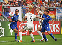 20170721 - TILBURG , NETHERLANDS : German Mandy Islacker (M) with Italian Marta Carissimi (L) and Daniela Stracchi (R) pictured during the female soccer game between Germany and Italy  , the second game in group B at the Women's Euro 2017 , European Championship in The Netherlands 2017 , Friday 21 th June 2017 at Stadion Koning Willem II  in Tilburg , The Netherlands PHOTO SPORTPIX.BE | DIRK VUYLSTEKE