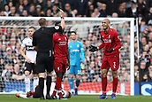 17th March 2019, Craven Cottage, London, England; EPL Premier League football, Fulham versus Liverpool; Fabinho of Liverpool is shown a yellow card