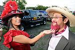 Bruna Dew checks out Fujio Watanabe's pink beard at the 2010 Art Car Ball at the Orange Show Monument & Warehouse Thursday May 06,2010.  (Dave Rossman Photo)