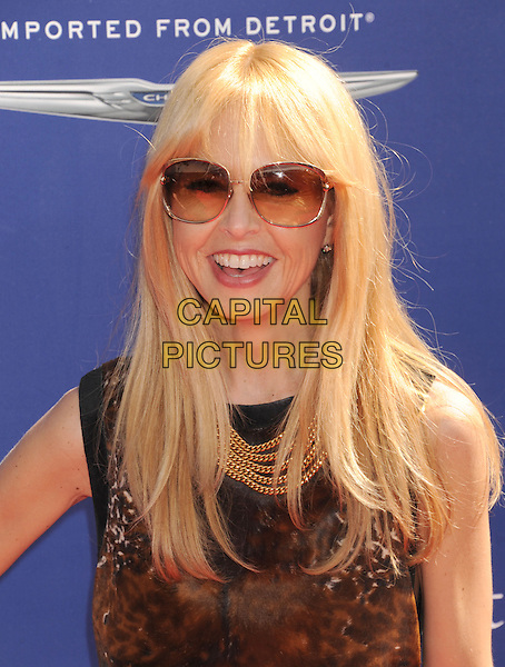 Rachel Zoe.10th Annual John Varvatos Stuart House Benefit held at John Varvatos Boutique, Beverly Hills, California, USA..March 10th, 2013.headshot portrait black brown print top sunglasses shades gold necklace.CAP/ROT/TM.©Tony Michaels/Roth Stock/Capital Pictures