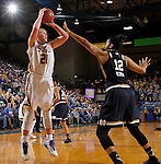 BROOKING, SD - NOVEMBER 21:  Clarissa Ober #21 from South Dakota State spots up for a jumper over Taya Reimer #12 from Notre  Dame in the second half of their game Saturday afternoon at Frost Arena in Brookings. (Photo by Dave Eggen/Inertia)