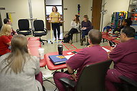 NWA Democrat-Gazette/ANDY SHUPE<br /> Kaylee Henry, a biomedical engineering student at the University of Arkansas, speaks Tuesday, April 10, 2018, to clinicians as she and other students present ideas for solutions to everyday problems health care providers encounter during a meeting with staff at the UAMS outpatient therapy clinic in Fayetteville.