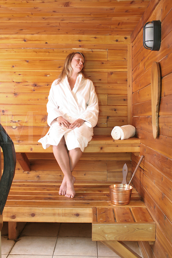 Released health spa woman relaxing in sauna