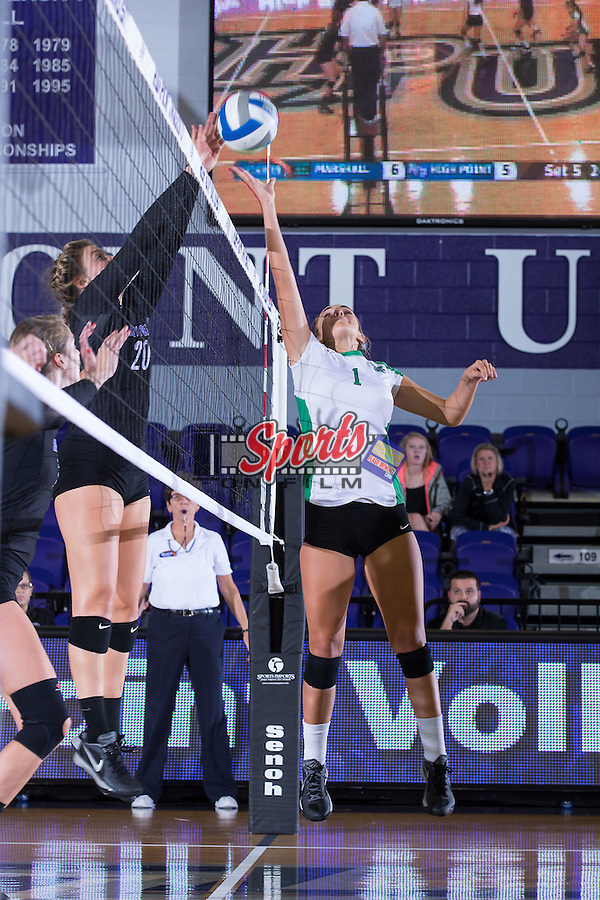 Kayla Simmons (1) of the Marshall Thundering Herd battles at the net with Haley Barnes (20) of the High Point Panthers at the Panther Invitational at the Millis Athletic Center on September 12, 2015 in High Point, North Carolina.  The Thundering Herd defeated the Panthers 3-2.   (Brian Westerholt/Sports On Film)
