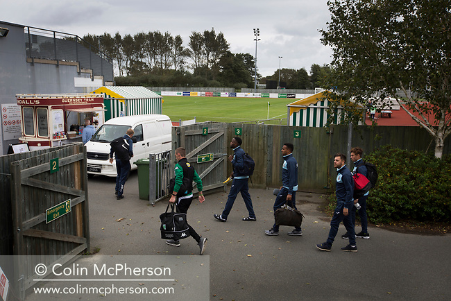 Rival players arriving at the ground as Guernsey take on Corinthian-Casuals in a Isthmian League Division One South match at Footes Lane. Formed in 2011, Guernsey FC are a community club located in St. Peter Port on the island of Guernsey and were promoted to the Isthmian League Division One South in 2013. The visitors from Kingston upon Thames won the fixture by 1-0, watched by a crowd of 614 spectators.