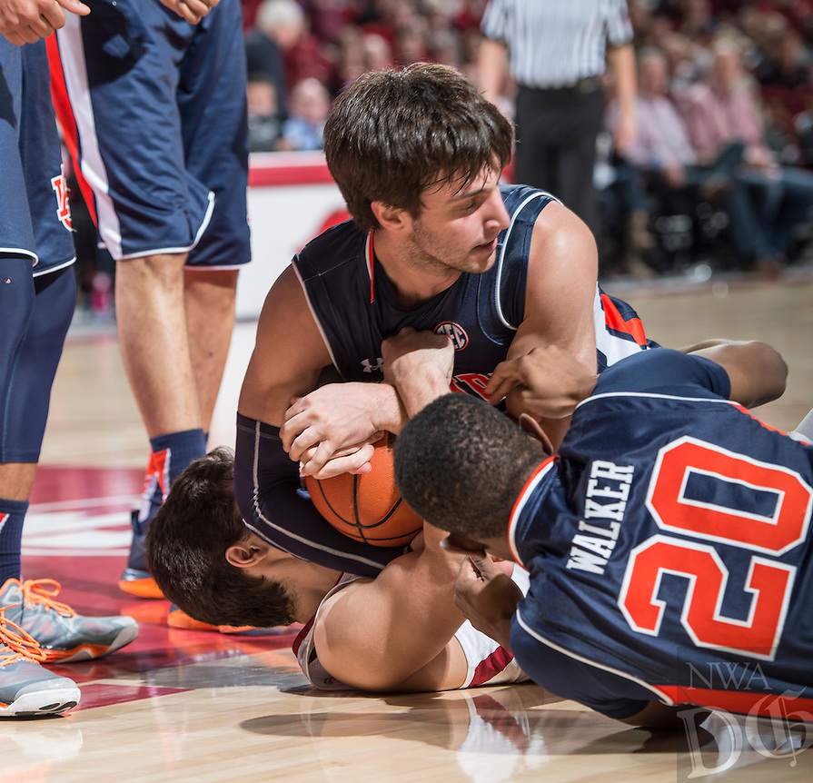 NWA Democrat-Gazette/ANTHONY REYES &bull; @NWATONYR<br /> Arkansas Razorbacks guard Dusty Hannahs (3) battles for a loose ball with Auburn Tigers guard Patrick Keim (21) and Auburn Tigers guard Jonathan Walker (20) in the second half Wednesday, Feb. 17, 2016 at Bud Walton Arena in Fayetteville. The Razorbacks lost 90-86.
