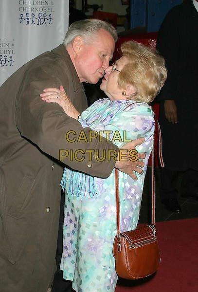 JON VOIGHT & DR. RUTH.Children at The Heart Benefit for the Children of Chernobyl.Pier 60 Chelsea Piers, New York City, New York, USA,.November 22nd 2004..half length greeting kissing.Ref: IW.www.capitalpictures.com.sales@capitalpictures.com.©Capital Pictures.