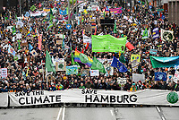 GERMANY, Hamburg city, Fridays for future movement, Save the Climate rally with 30.000 protesters for climate protection, in first row, above the R in Hamburg: swedish activist Greta Thunberg with her banner skolstrejk för klimatet, / DEUTSCHLAND, Hamburg, Fridays-for future Bewegung, Demo fuer Klimaschutz, erste Reihe über dem R im Wort Hamburg: Greta Thunberg mit ihrem Plakat skolstrejk för klimatet, 21.2.2020