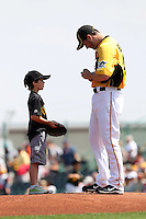 Pittsburgh Pirates pitcher Erik Bedard #45 signs an autograph before a spring training game against the Minnesota Twins at McKechnie Field on March 10, 2012 in Bradenton, Florida.  Minnesota defeated Pittsburgh 4-2.  (Mike Janes/Four Seam Images)