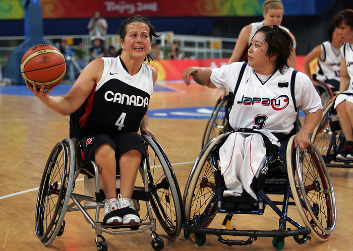 Jennifer Krempien (4) of Richmond, B.C. tries to get around Mika Takabayashi of Japan in women's wheelchair basketball action at the Paralympic Games in Beijing,Tuesday, Sept., 9, 2008.    Photo by Mike Ridewood/CPC