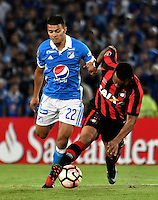 BOGOTA- COLOMBIA – 08-02-2017: John Duque (Izq.) jugador de Millonarios de Colombia, disputa el balon con Carlos Alberto (Der) jugador de Atletico Paranaense de Brasil, durante partido entre Millonarios de Colombia y Atletico Paranaense de Brasil, por la segunda fase, llave 1 de la Copa Conmebol Libertadores Bridgestone 2017, en el estadio Nemesio Camacho El Campin, de la ciudad de Bogota. / John Duque (L) player of Millonarios of Colombia, figths for the ball with Carlos Alberto (R) player of Atletico Paranaense of Brasil, during a match between Millonarios of Colombia and Atletico Paranaense of Brasil, for the second phase, key1, of the Conmebol Copa Libertadores Bridgestone 2017 at the Nemesio Camacho El Campin in Bogota city. VizzorImage / Luis Ramirez / Staff.