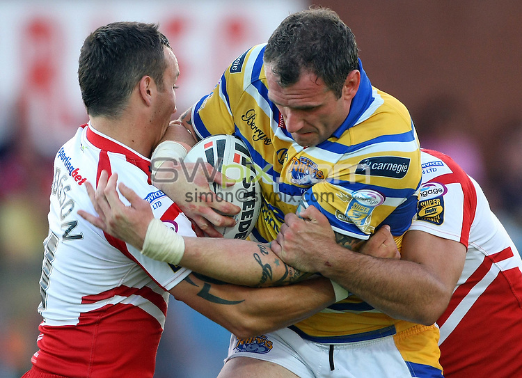 PICTURE BY VAUGHN RIDLEY/SWPIX.COM - Rugby League - Super League - Hull KR v Leeds - Craven Park, Hull, England - 09/07/10...Copyright - Simon Wilkinson - 07811267706...Leeds Jamie Peacock is tackled by Hull KR's Josh Hodgson.