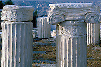 Column pieces, with Ionic capital on right, from fallen buildings on the Acropolis.