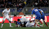 Rugby, torneo Sei Nazioni 2013: Italia vs Francia. Roma, stadio Olimpico, 3 febbraio 2013..France's Mathieu Bastareaud is tackled by Italy's Alessandro Zanni, n.6, and Simone Favaro, n.7 during the Six Nations rugby union international match between Italy and France, at Rome's Olympic stadium, 3 February 2013..UPDATE IMAGES PRESS/Riccardo De Luca