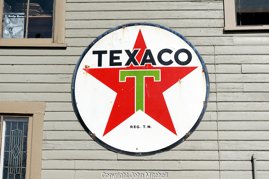 Old Texaco gas station sign on a building in La Conner, Washington state, USA