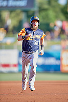 Nick Martini (38) of the Las Vegas Aviators hustles to third base against the Salt Lake Bees at Smith's Ballpark on July 20, 2019 in Salt Lake City, Utah. The Aviators defeated the Bees 8-5. (Stephen Smith/Four Seam Images)