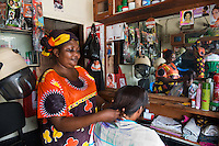 BRAC PROJECT. Carolina Augustino Ndaki.Runs Celina Hair Salon (named after her daughter), with help from microfinace loan from BRAC. Been here 9 years so has regular customers. Strated ith $150 loan, now has $900 loan.