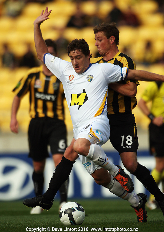 Ben Sigmund pressure Gold Coast's Joel Porter during the A-League football match between Wellington Phoenix and Gold Coast United at Westpac Stadium, Wellington, New Zealand on Sunday, 25 October 2009. Photo: Dave Lintott / lintottphoto.co.nz