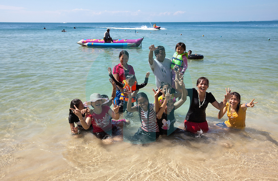 January 7th, 2009_SIHANOUKVILLE, CAMBODIA_ A group of friends enjoy the beach in Sihanoukville, which is on Cambodia's southern coast.  Sihanoukville is Cambodia's main sun and surf tourist destination.  Photographer: Daniel J. Groshong/Tayo Photo Group