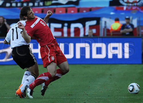Miroslav Klose (L) of Germany vies with Branislav Ivanovic of Serbia during the FIFA World Cup 2010 group D match between Germany and Serbia at the Nelson Mandela Bay Stadium in Port Elizabeth, South Africa 18 June 2010.