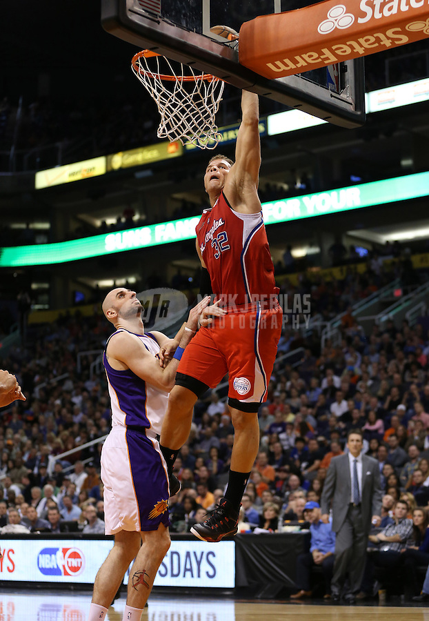 Jan. 24, 2013; Phoenix, AZ, USA: Los Angeles Clippers forward Blake Griffin (32) dunks the ball against Phoenix Suns center Marcin Gortat (4) at the US Airways Center. The Suns defeated the Clippers 93-88. Mandatory Credit: Mark J. Rebilas-USA TODAY Sports