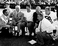 1959: Chuck Taylor and others during an Alumni game.