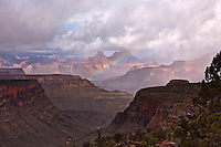 A rainbow arches over Cottonwood Canyon and Horseshoe Mesa on the Grandview Trail below the South Rim of the Grand Canyon.