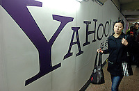 A chinese young lady walks past a Yahoo! China advertisement in Beijing, China..