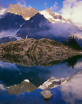 North Cascades National Park, WA<br /> Afternoon light on Mount Shuksan with clearing fog and a mirror reflection in Lake Ann