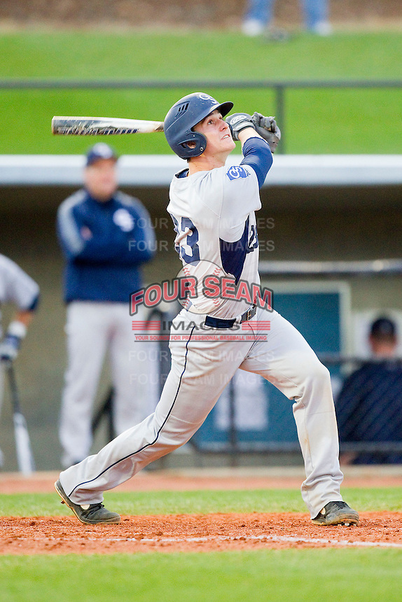 Chase Griffin (23) of the Georgia Southern Eagles follows through on his swing against the UNCG Spartans at UNCG Baseball Stadium on March 29, 2013 in Greensboro, North Carolina.  The Spartans defeated the Eagles 5-4.  (Brian Westerholt/Four Seam Images)