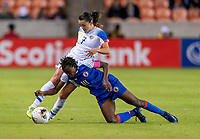 HOUSTON, TX - JANUARY 31: Melissa Herrera #7 of Costa Rica fights for the ball with Nerilia Mondesir #10 of Haiti during a game between Haiti and Costa Rica at BBVA Stadium on January 31, 2020 in Houston, Texas.