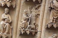 The prophet Amos with a house on fire, and sheep mating, on the third vault of the left-hand archivolts of the tympanum of the South portal or St Honore portal on the South transept of the Basilique Cathedrale Notre-Dame d'Amiens or Cathedral Basilica of Our Lady of Amiens, built 1220-70 in Gothic style, Amiens, Picardy, France. St Honore or Honoratus was the 7th bishop of Amiens who lived in the 6th century AD. Amiens Cathedral was listed as a UNESCO World Heritage Site in 1981. Picture by Manuel Cohen