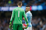 Sergio Aguero of Manchester City chats with David de Gea of Manchester United during a break in play during the Barclays Premier League match at Old Trafford. Photo credit should read: Philip Oldham/Sportimage